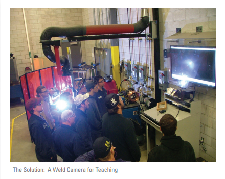 Students viewing a weld demonstration on a display monitor.