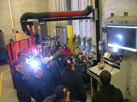 Students viewing a live weld