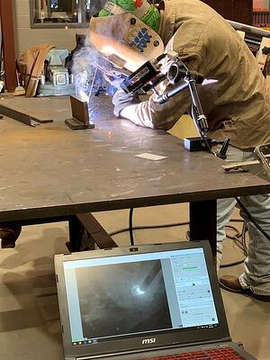 The Xiris weld camera being used in a classroom environment by a weld educator